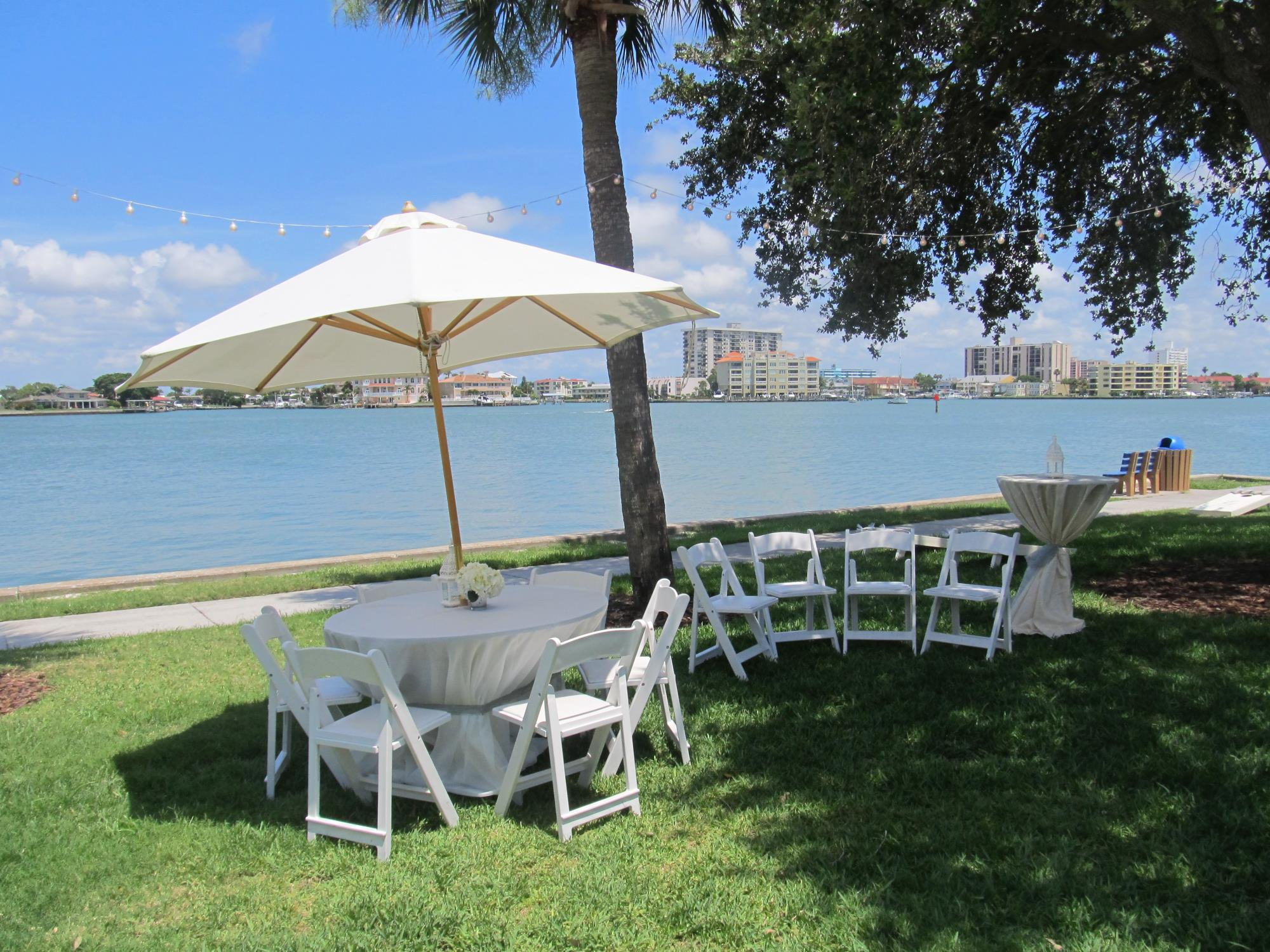 Image of the beach complex chairs and tables overloooking the inland waterway