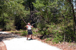 Bike/Hiking trail and man with fishing poles