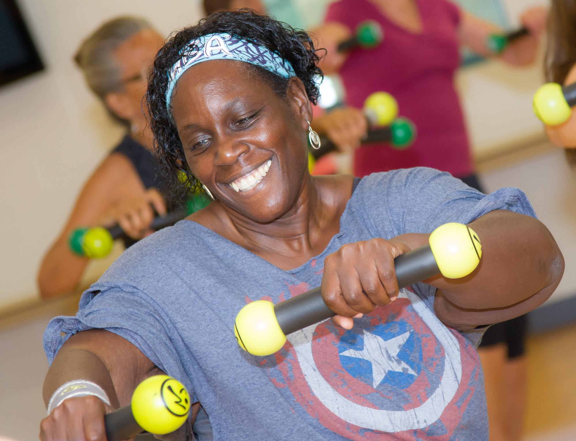 Woman doing Zumba with weights